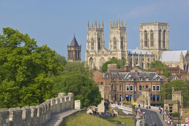 York Minster, northern Europe's largest Gothic cathedral, and a section of the historic city walls along Station Road, York, Yorkshire, England, United Kingdom, Europe